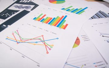 business-report-graphs-and-charts-business-reports-and-pile-of-documents-business-concept